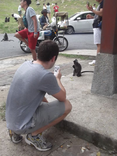 Steve photographing a monkey in Malaysia